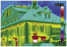Hot spots in this thermal image indicate warmth leaking from the building, probably due to faulty insulation.